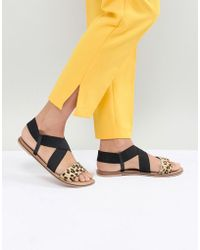 Accessorize - Leopard Elastic Cross Strap Flat Sandals - Lyst