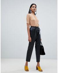 Mango - Peg Faux Leather Pants - Lyst