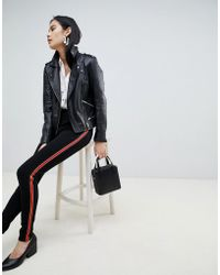 Pieces - Camille Sports Stripe leggings - Lyst