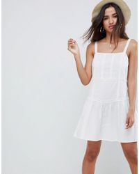 26e1a5e49d9 ASOS Mini Sundress With Strappy Back And Wrap Front in White - Lyst