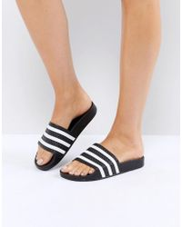 reputable site 7dc44 d3c8d adidas Originals - Originals Adilette Slider Sandals In Black - Lyst