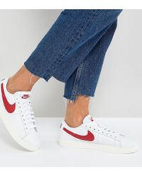 8bcd0ed143d30 ... promo code for nike blazer trainers in white and red lyst 23d3b 44288