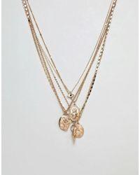 ASOS - Collar a capas con colgantes combinados en dorado de - Lyst