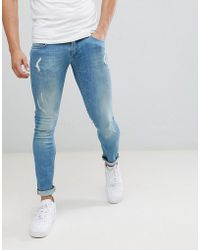 Religion - Skinny Fit Jeans With Stretch And Rips In Blue - Lyst