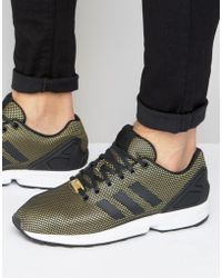 differently c323a 32f65 ... adidas originals zx flux sneakers in gold lyst