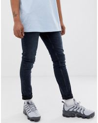 f5a42f9cacf Cheap Monday Tight Skinny Jeans With Blown Out Knees in Blue for Men - Lyst