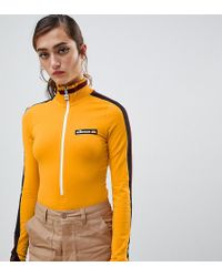 Ellesse - High Neck Body With Zip Front And Contrast Stripe Sleeve - Lyst