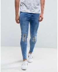 Illusive London - Super Skinny Jeans In Mid Wash Blue With Knee Rips - Lyst