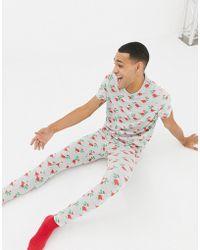 ASOS - meggings In Christmas Dinosaur Print - Lyst