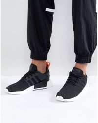 9ab6ce5a7 adidas Originals Nmd R1 Primeknit Sneakers In Black By3013 in Black ...