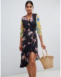 Liquorish - Patchwork Floral Print Asymmetric Wrap Midi Dress - Lyst