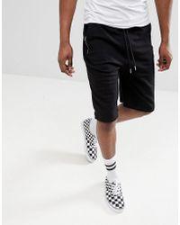 ASOS - Design Jersey Oversized Shorts In Black - Lyst