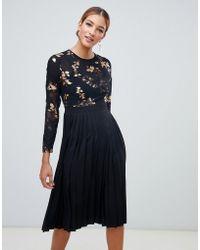Little Mistress - Foil Print Mini Dress With Pleated Skirt In Black Multi - Lyst