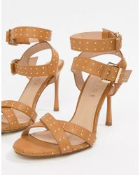 1150317ed2c7 Dune. Isadora T-bar Sandals. £38. Amazon · Office - Hardcore Studded Camel  Strappy Heeled Sandals - Lyst