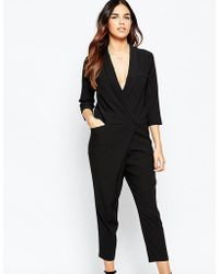 970dd9c6d4ff Lyst - ASOS Wrap Front Jersey Jumpsuit With Long Sleeves in Black