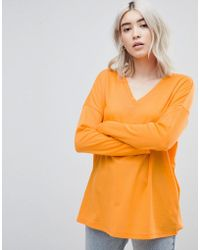 ASOS - Top With V-neck In Oversized Lightweight Rib In Orange - Lyst