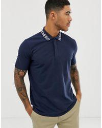 d8d6af72ba8 HUGO - Polo azul marino con logo en el cuello Dewayne - Lyst