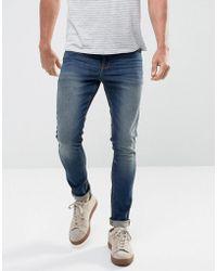 ASOS DESIGN - Asos Super Skinny Jeans In 12.5oz Dark Wash Blue - Lyst