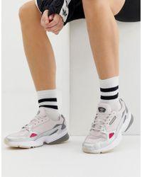 58f50da4dc28 Lyst - adidas Originals Falcon Sneakers In White And Gold in White