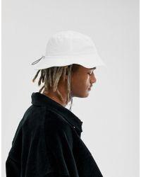 c3cb9807889b7 ASOS Safari Bucket Hat In Camel With Wide Brim in Natural for Men - Lyst