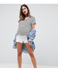ASOS - Asos Design Maternity Petite Denim Alvey Mid Rise Short With Raw Hem In White - Lyst