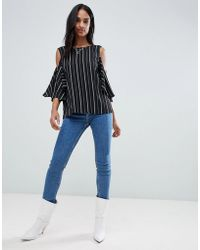 26fa74b9accba3 Lyst - Cheap Monday Cold Shoulder Top in Metallic