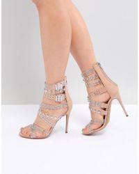 51ee7f65175 Steve Madden Slithur Gold Glitter Caged Heeled Sandals in Metallic ...
