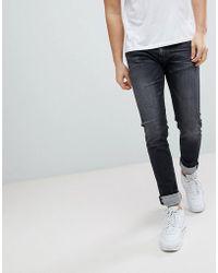 Replay - Jondrill Washed Black Skinny Jeans - Lyst