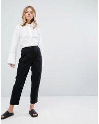Monki - High Waist Peg Leg Trousers - Lyst