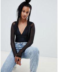 Ivy Park - Mesh Hooded Bodysuit - Lyst