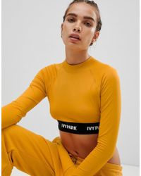 Ivy Park - Active Long Sleeve Crop Top In Yellow - Lyst