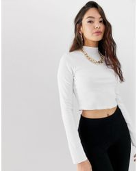ASOS - Long Sleeve Crop Top With Turtleneck And Raw Hem In Rib In White - Lyst