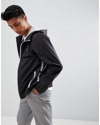 Hollister - Hooded Windbreaker Jacket Seagull Logo In Black - Lyst