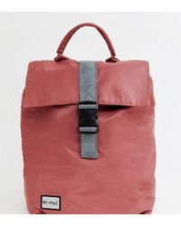 Mi-Pac - Nylon Fold Top Backpack In Rose Pink With Reflective Logo - Lyst