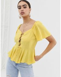 02ae0c8e4100f3 ASOS - Tea Blouse With Lace Up Front Detail - Lyst