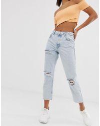 Bershka - Schmale Jeans in Blau mit Rissen - Lyst