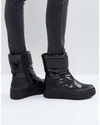 CALVIN KLEIN 205W39NYC - Jeans Leonie Black Quilted Boots - Lyst