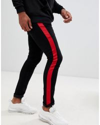 ASOS - Super Skinny Jeans In Black With Red Side Stripe - Lyst