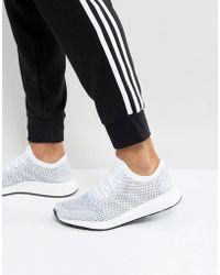 new styles 6b5ce 8244e adidas Originals - Zapatillas de deporte en blanco CG4126 Swift Run  Primeknit de - Lyst