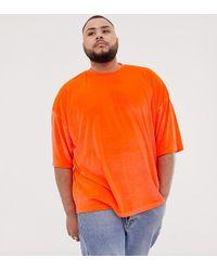 ASOS - T-shirt oversize a mezze maniche in velour arancione fluo - Lyst