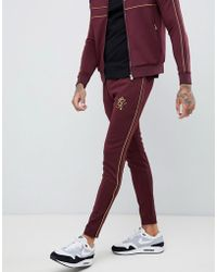 Gym King - Skinny joggers In Burgundy With Gold Side Stripes - Lyst