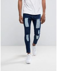 Illusive London | Super Skinny Jeans In Dark Wash Blue With Distressing | Lyst