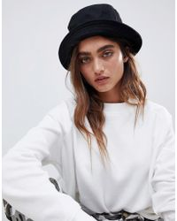 e12a612b8ed Lyst - ASOS Unicorn Trim Floppy Hat in Black
