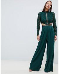 ASOS - Premium Cut Out Lace Jumpsuit - Lyst