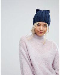 dbaf2024a3f Helene Berman Taupe Knit Hat With Double Pom Pom - Lyst
