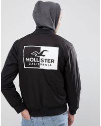 Hollister - Back Logo Stretch Bomber Jacket With Sweat Hood In Black - Lyst
