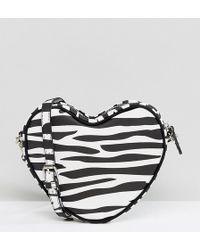 Lazy Oaf - Exclusive Zebra Print Heart Cross Body Bag - Lyst