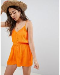 ASOS DESIGN - Playsuit In Crinkle With Button Front - Lyst