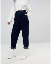ASOS - Tapered Jeans With Curved Seams And Belt In Indigo Wash - Lyst