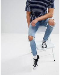 Cheap Monday - Tight Skinny Jeans With Blown Out Knees - Lyst